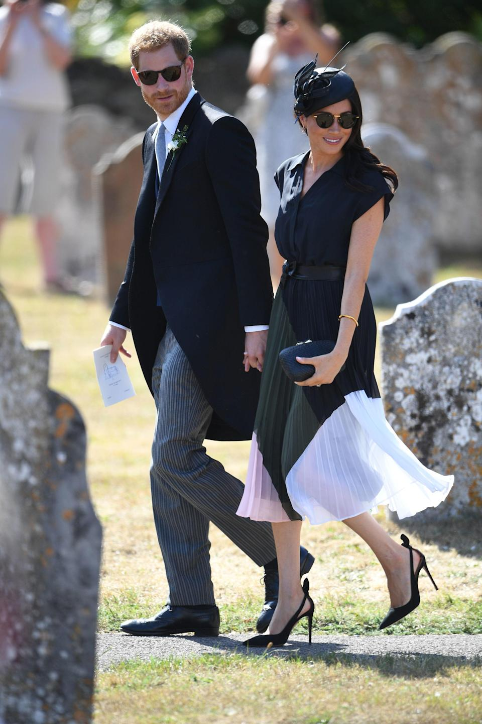 <p>On her birthday on August 4th, Meghan spent the day at the wedding of Prince Harry's best friend, Charlie van Straubenzee, and Daisy Jenkins. For the occasion, Meghan wore a pleated shirt dress by Club Monaco with her favourite Aquazzure heels, a Philip Treacy facinator an clutch by Kayu. <br><em>[Photo: PA]</em> </p>