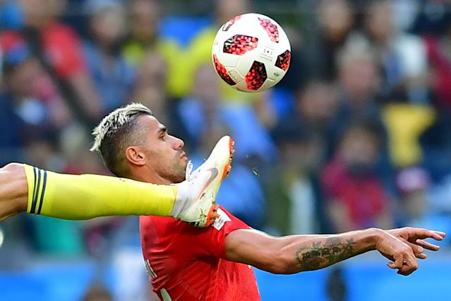 <p>Sweden's forward Marcus Berg (L) fights for the ball with Switzerland's midfielder Valon Behrami during the Russia 2018 World Cup round of 16 football match between Sweden and Switzerland at the Saint Petersburg Stadium in Saint Petersburg on July 3, 2018. (Photo by Giuseppe CACACE / AFP) </p>