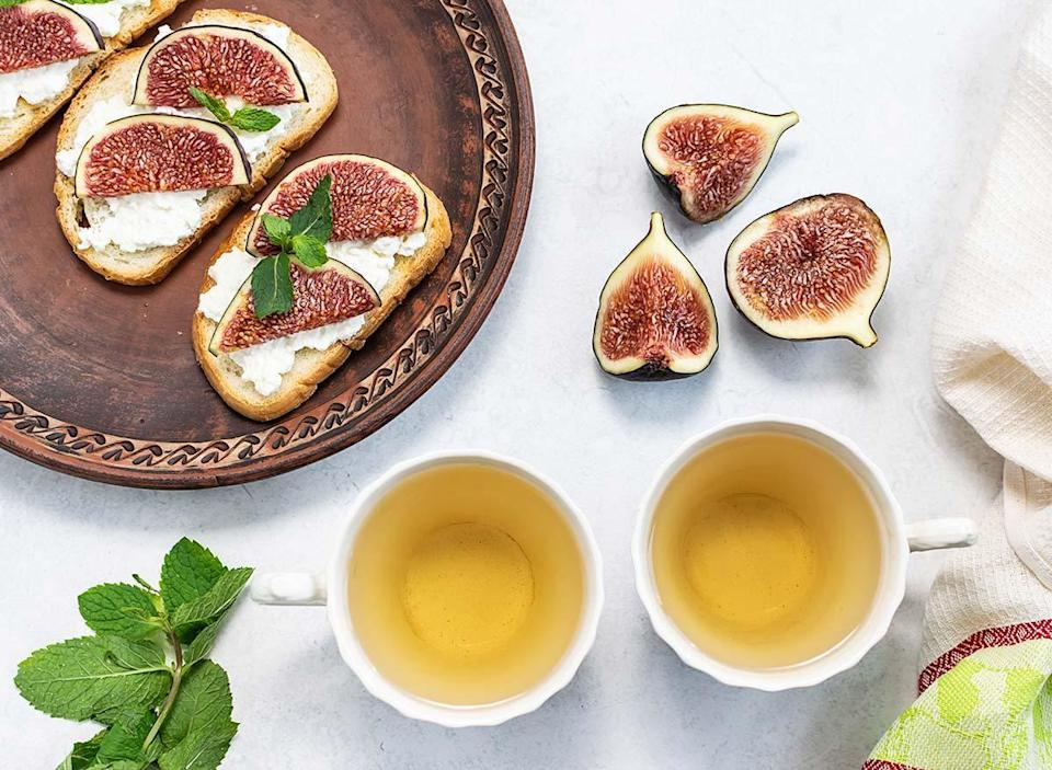 fig toast with cups of green tea