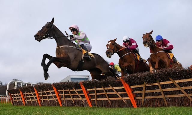 Sharjah, ridden by Patrick Mullins, jumps the last ahead of Samcro (Jack Kennedy, white cap) who fades into fifth.