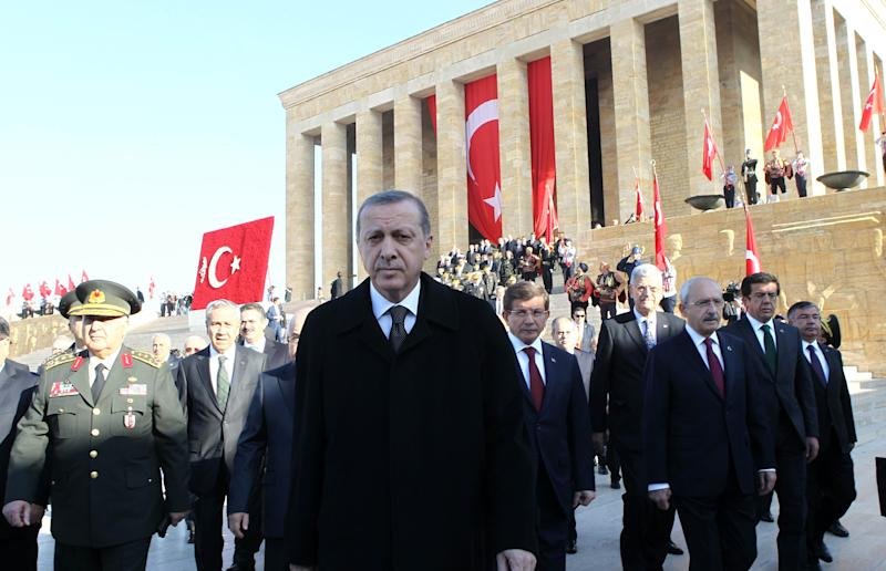Turkish President Tayyip Erdogan (C) at the mausoleum of Mustafa Kemal Ataturk, on November 10, 2014 in Ankara