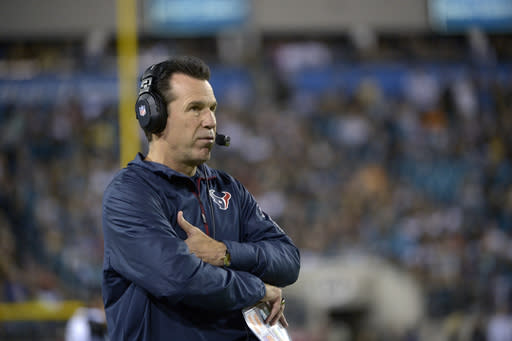 Houston Texans head coach Gary Kubiak watches from the sideline during the first half of an NFL football game against the Jacksonville Jaguars in Jacksonville, Fla., Thursday, Dec. 5, 2013.(AP Photo/Phelan M. Ebenhack)