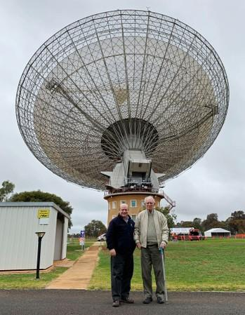 Cooke, senior receiver engineer at the Parkes radio telescope in 1969, and Sarkissian, operations scientist at the telescope, stand together at the Parkes Observatory near the town of Parkes