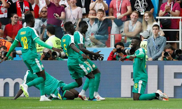 Soccer Football - World Cup - Group H - Poland vs Senegal - Spartak Stadium, Moscow, Russia - June 19, 2018 Senegal's M'Baye Niang celebrates scoring their second goal with team mates REUTERS/Christian Hartmann