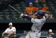 Seattle Mariners' Denard Span hits a sacrifice fly during the 11th inning against the Baltimore Orioles in a baseball game Wednesday, June 27, 2018, in Baltimore. Jean Segura scored on the go-ahead run. Seattle won 8-7 in 11 innings. (AP Photo/Patrick Semansky)