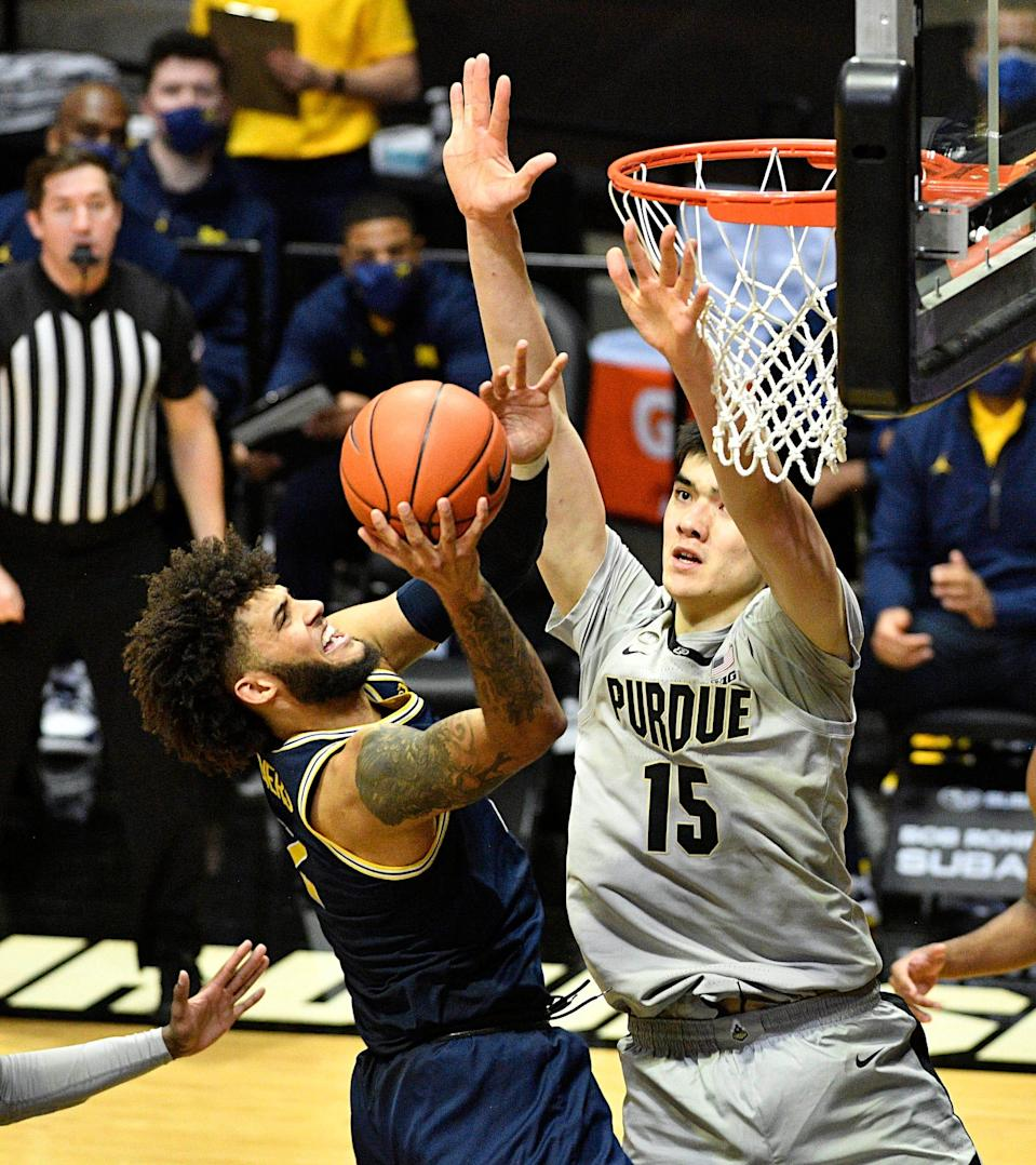 Michigan forward Isaiah Livers takes a shot against Purdue center Zach Edey during the second half at Mackey Arena in West Lafayette, Ind. on Jan. 22, 2021.