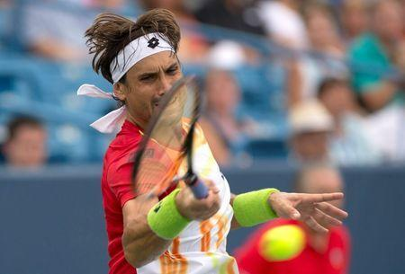 David Ferrer (ESP) returns a shot against Julien Benneteau (not pictured) on day six of the Western and Southern Open tennis tournament at Linder Family Tennis Center. Aaron Doster-USA TODAY Sports
