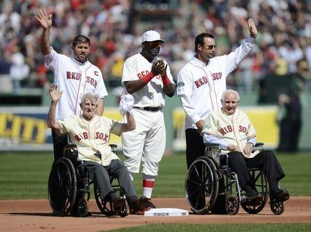 FILE PHOTO: (top L - R) Former Boston Red Sox player Jason Varitek, current player David Ortiz, former player Tim Wakefield wave to the crowd along with (bottom L - R) former Red Sox players Johnny Pesky and Bobby Doerr during the pre-game ceremony as Fenway Park commemorates its 100th year anniversary before the start of American League MLB baseball game between the Boston Red Sox and New York Yankees at Fenway Park in Boston, Massachusetts April 20, 2012. REUTERS/Gretchen Ertl