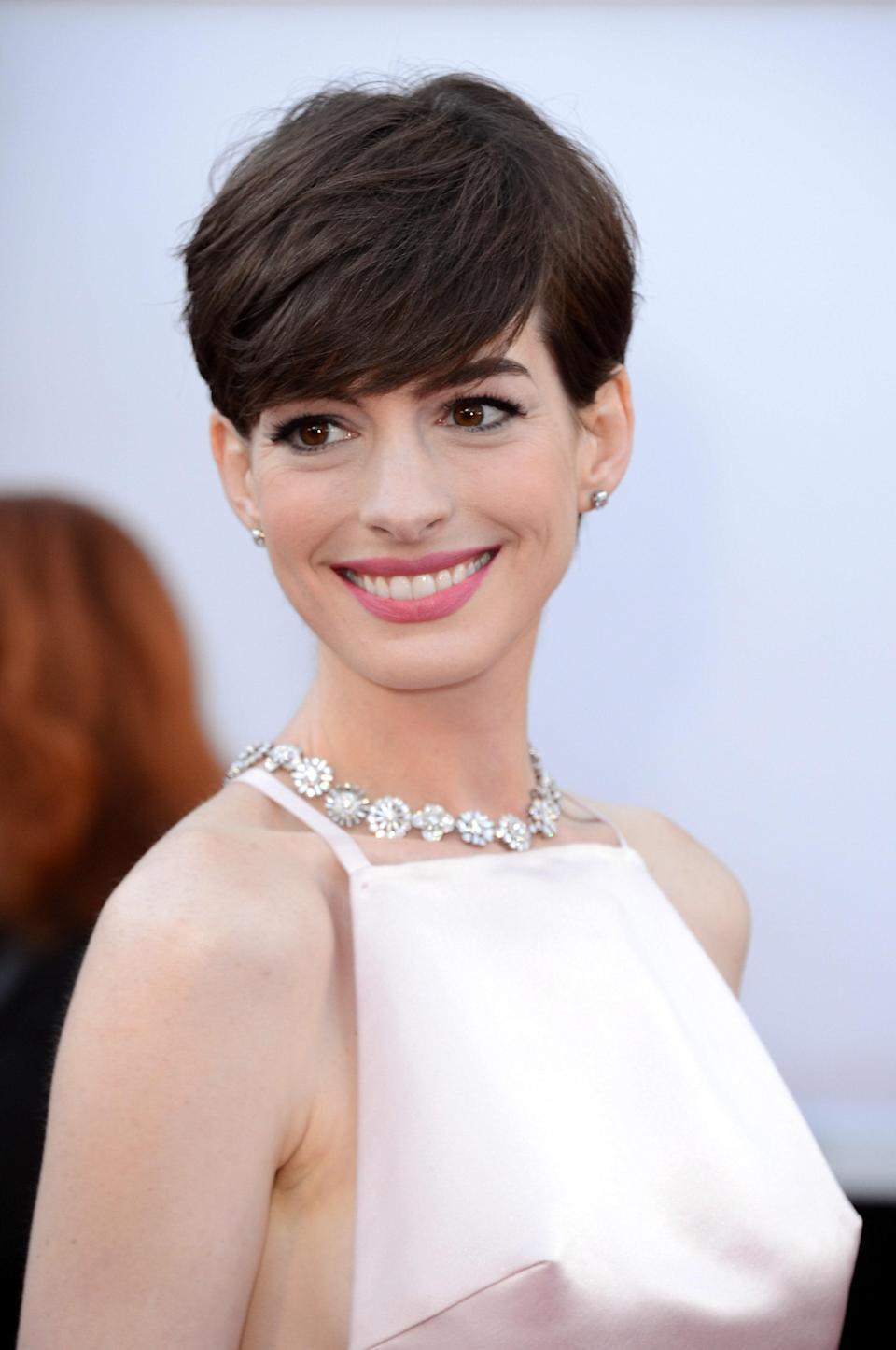 The heavy bangs and short sides look amazing on Hathaway—and create a polished, ultra classic look.