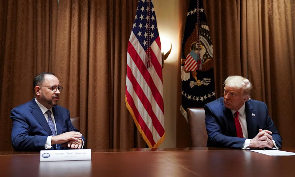 U.S. President Donald Trump listens to remarks from Robert Unanue, CEO of Goya Foods, prior to signing an Executive Order on the White House Hispanic Prosperity Initiative at the White House in Washington, U.S., July 9, 2020. Picture taken July 9, 2020. REUTERS/Kevin Lamarque