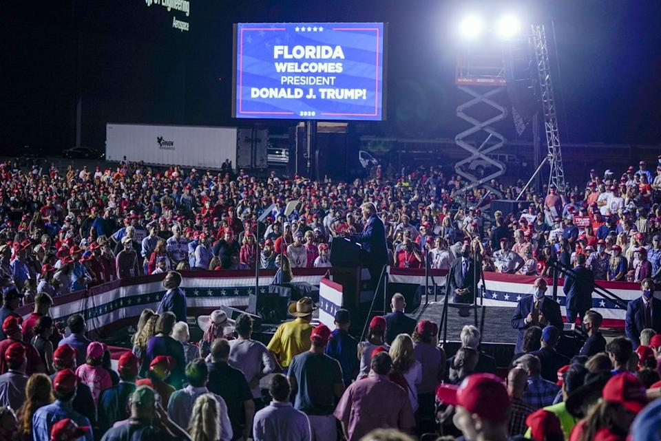 Hundreds of supporters surround Donald Trump at a rally.