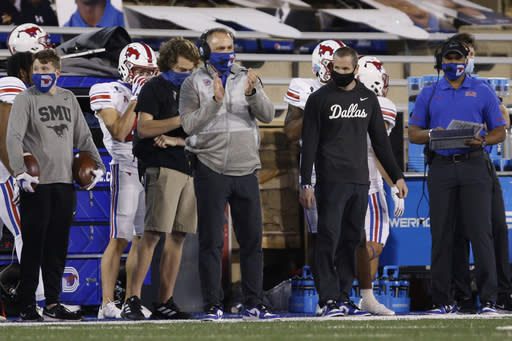 SMU coach Sonny Dykes applauds during the second half of the team's NCAA college football game against Tulsa in Tulsa, Okla., Saturday, Nov. 14, 2020. (AP Photo/Joey Johnson)