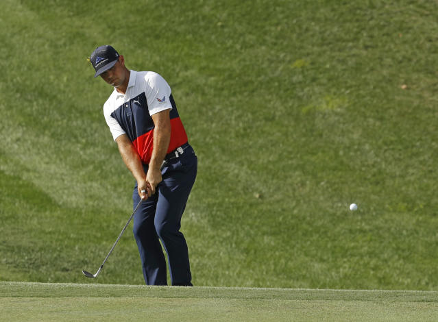 Gary Woodland chips to the 15th green during the first round of the PGA Championship golf tournament at Bellerive Country Club, Thursday, Aug. 9, 2018, in St. Louis. (AP Photo/Charlie Riedel)