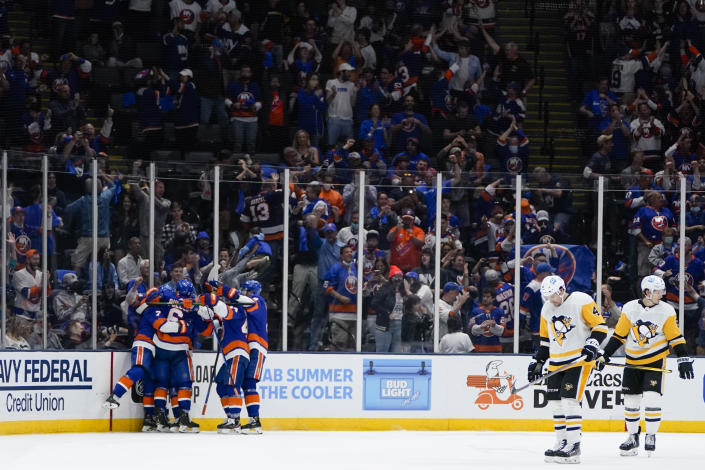 The New York Islanders celebrate a goal by Jordan Eberle during the third period of Game 4 of an NHL hockey Stanley Cup first-round playoff series against the Pittsburgh Penguins, Saturday, May 22, 2021, in Uniondale, N.Y. The Islanders won 4-1. (AP Photo/Frank Franklin II)
