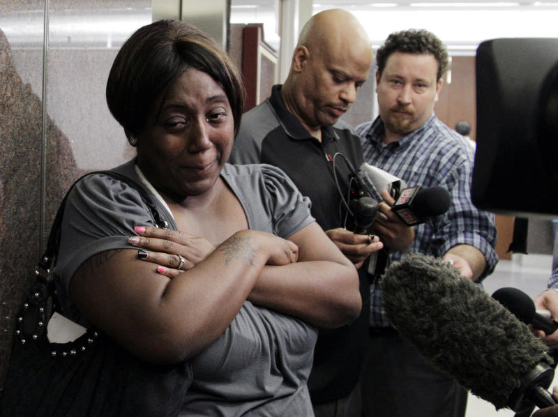 File - In this March 15, 2012 file photo, Auboni Champion-Morin, left, turns away from reporters after a status hearing in juvenile court, in Houston. Jurors in San Augustine, Texas, found Krystle Tanner and her mother, Gloria Walker, guilty Tuesday, Feb. 19, 2013 of kidnapping Champion-Morin's son, Miguel Morin, now 8, who disappeared in 2004. Walker also was found guilty of injury to a child, while the jury found Tanner guilty of a lesser charge of reckless injury to a child. (AP Photo/Pat Sullivan, File)
