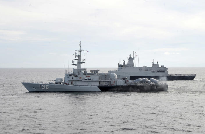 In this photo released by The Royal Malaysian Navy, Royal Malaysian Navy's missile corvette KD Laksamana Muhammad Amin, front, and Royal Malaysian Navy's offshore patrol vessel KD Selangor are seen during a search and rescue operation for the missing Malaysia Airlines plane over the Straits of Malacca, Malaysia, Thursday, March 13, 2014. Planes sent Thursday to check the spot where Chinese satellite images showed possible debris from the missing Malaysian jetliner found nothing, Malaysia's civil aviation chief said, deflating the latest lead in the six-day hunt. The hunt for the missing Malaysia Airlines flight 370 has been punctuated by false leads since it disappeared with 239 people aboard about an hour after leaving Kuala Lumpur for Beijing early Saturday. (AP Photo/The Royal Malaysian Navy)