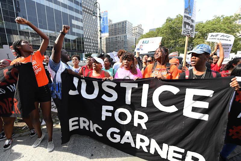 Eric Garner's mother, Gwen Carr, in pink, protests in Foley Square in New York with others on July 17, 2019.
