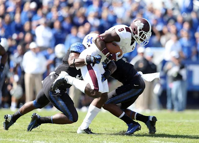 LEXINGTON, KY - OCTOBER 06: Chris Smith #8 of the Mississippi State Bulldogs runs with the ball while defended by Mikie Benton #31 and Martavius Neloms #1 of the Kentucky Wildcats during the SEC game at Commonwealth Stadium on October 6, 2012 in Lexington, Kentucky. (Photo by Andy Lyons/Getty Images);