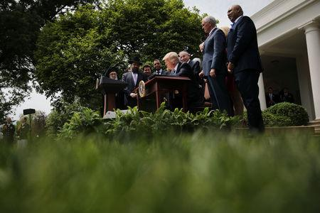 U.S. President Donald Trump signs an Executive Order on Promoting Free Speech and Religious Liberty during the National Day of Prayer event at the Rose Garden of the White House in Washington D.C., U.S., May 4, 2017. REUTERS/Carlos Barria