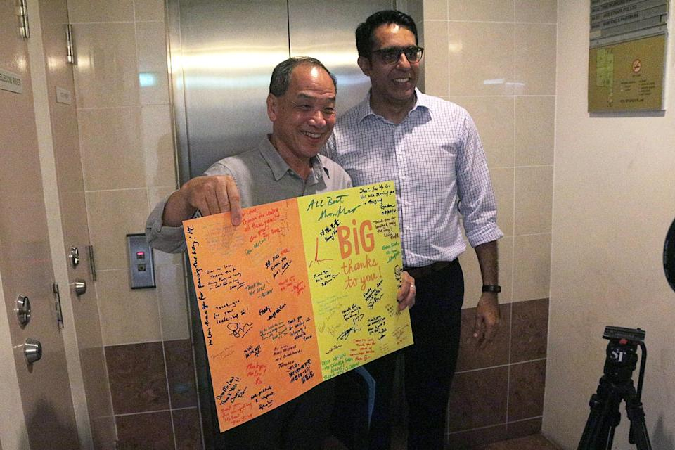 Former Workers' Party chief Low Thia Khiang poses with his successor Pritam Singh following the opposition party's leadership elections on 8 April, 2018. PHOTO: Yahoo News Singapore/Dhany Osman