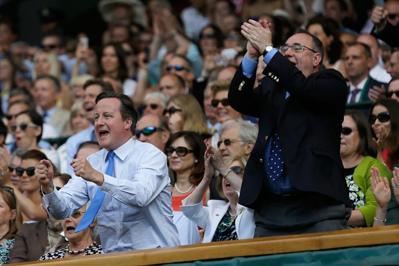 LONDON, ENGLAND - JULY 07: British Prime Minister David Cameron and First Minister of Scotland Alex Salmond celebrate during the Gentlemen's Singles Final match between Andy Murray of Great Britain and Novak Djokovic of Serbia on day thirteen of the Wimbledon Lawn Tennis Championships at the All England Lawn Tennis and Croquet Club on July 7, 2013 in London, England. (Photo by Anja Niedringhaus - Pool/Getty Images)