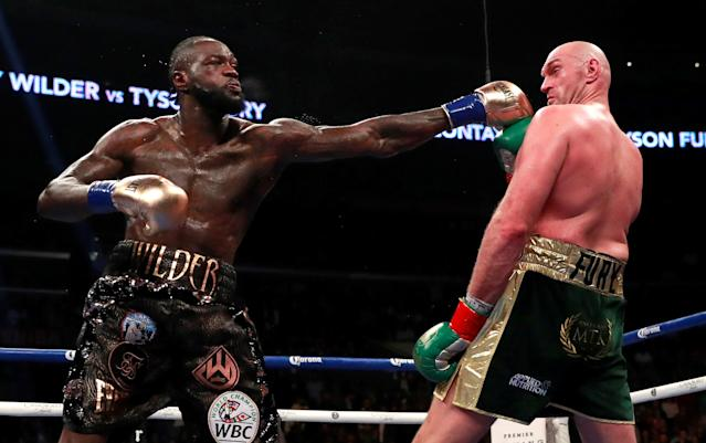 Deontay Wilder misses a punch against Tyson Fury. (Action Images via Reuters/Andrew Couldridge)