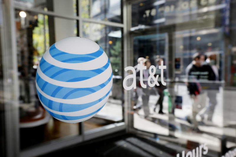 FILE - In this Wednesday, Oct. 17, 2012, file photo, an AT&T logo is displayed on an AT&T Wireless retail store front, in Philadelphia. T&T Inc. reports quarterly financial results before the market opensTuesday, April 23, 2013.  (AP Photo/Matt Rourke, File)