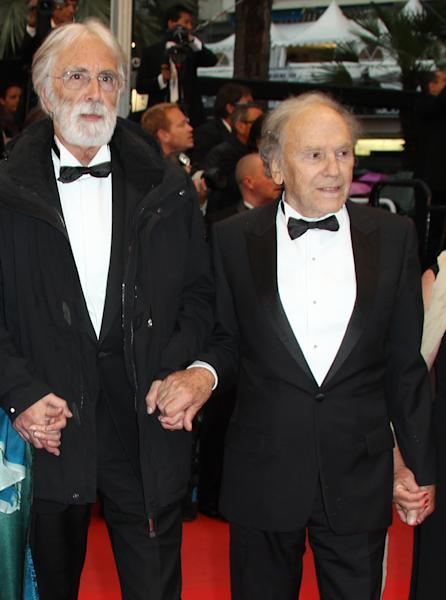 Director Michael Haneke, left, and actor Jean-Louis Trintignant arrive for the awards ceremony at the 65th international film festival, in Cannes, southern France, Sunday, May 27, 2012. (AP Photo/Joel Ryan)