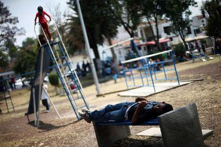 A Central American migrant, moving in a caravan through Mexico toward the U.S. border with fellow migrants, rests at a shelter set up for them in a park by the Catholic church, in Puebla, Mexico April 6, 2018. REUTERS/Edgard Garrido