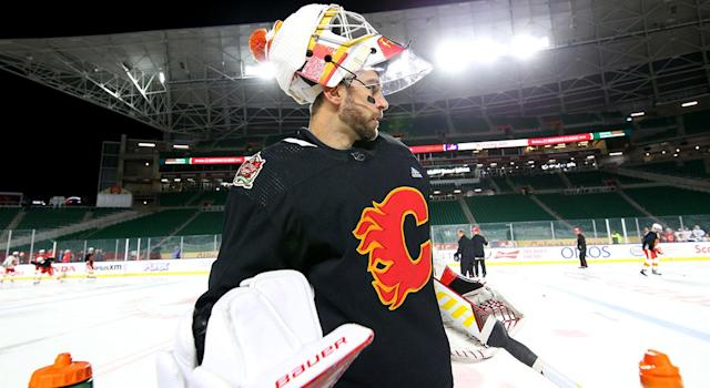 Cam Talbot of the Calgary Flames looks on during practice prior to the 2019 Tim Hortons NHL Heritage Classic at Mosaic Stadium. (Andre Ringuette/NHLI via Getty Images)