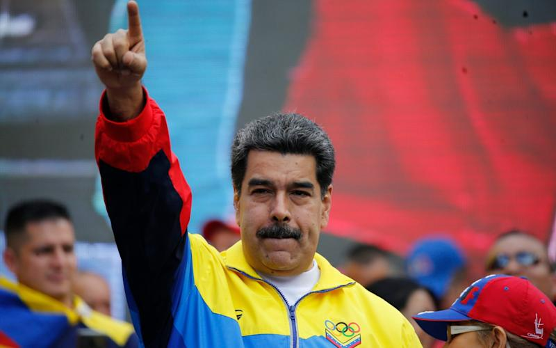 Nicolas Maduro, president of Venezuela, has been forced to find unusual ways of keeping cash flowing into his embattled country - AP