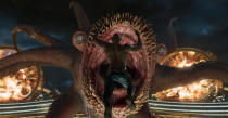 <p>Drax, daggers in hand, leaps into the mouth of this freaky-looking galactic monster, called an Abilisk. (Photo: Marvel) </p>