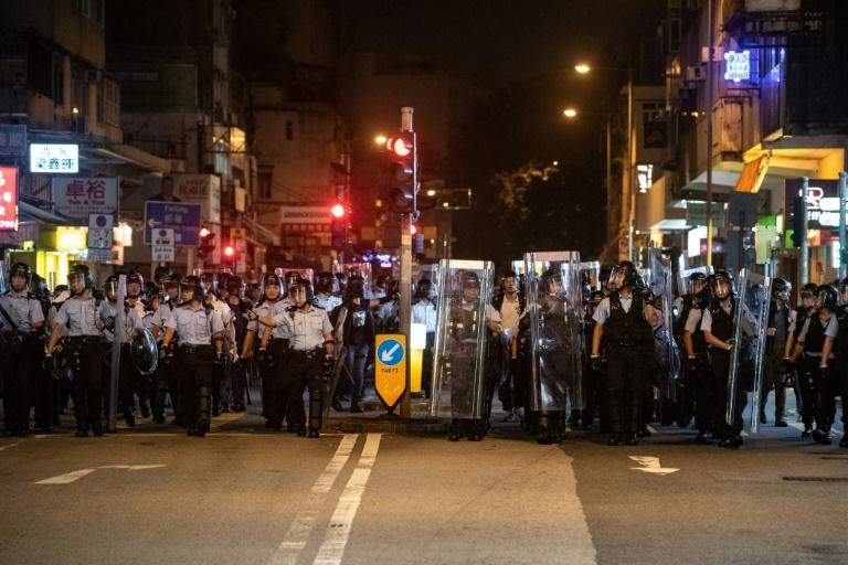 Clashes broke out between Hong Kong police and protesters as marchers  took aim at traders coming across the border from mainland China
