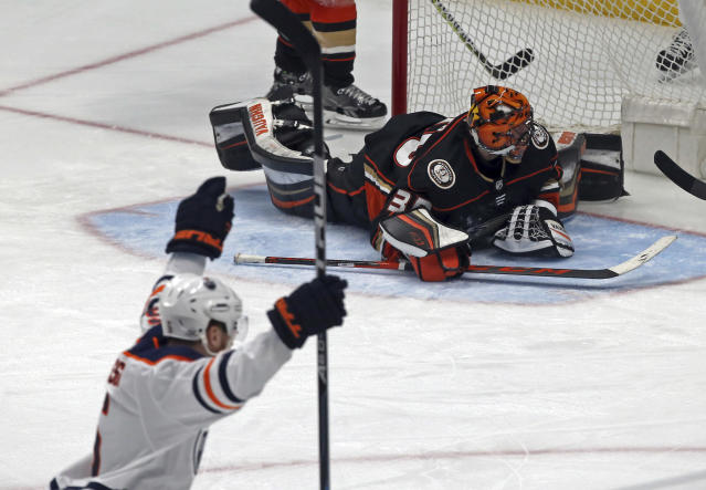 Anaheim Ducks goalie Ryan Miller can't stop a goal by Edmonton Oilers center Ryan Strome, not shown, in the second period of an NHL hockey game in Anaheim, Calif., Sunday, Feb. 25, 2018. (AP Photo/Reed Saxon)