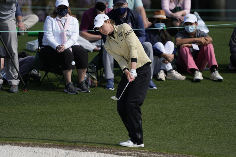 Emilia Migliaccio hits a chip shot on the 18th hole during a sudden-death playoff during the final round of the Augusta National Women's Amateur golf tournament at Augusta National Golf Club, Saturday, April 3, 2021, in Augusta, Ga. (AP Photo/David J. Phillip)