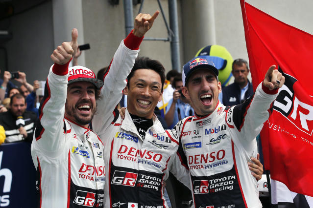 Drivers of the Toyota TS050 Hybrid No8 of the Toyota Gazoo Racing Team Sebastien Buemi of Switzerland, right, Fernando Alonso of Spain, left, and Kazuki Nakajima of Japan, celebrate after winning the 86th 24-hour Le Mans endurance race, in Le Mans, western France, Sunday, June 17, 2018. (AP Photo/Thibault Camus)