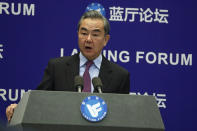 Chinese Foreign Minister Wang Yi delivers his opening remarks at the Lanting Forum on bringing China-U.S. relations back to the right track, at the Ministry of Foreign Affairs office in Beijing on Monday, Feb. 22, 2021. Wang Yi called on the U.S. Monday to lift restrictions on trade and people-to-people contacts while ceasing what Beijing considers unwarranted interference in the areas of Taiwan, Hong Kong, Xinjiang and Tibet. (AP Photo/Andy Wong)