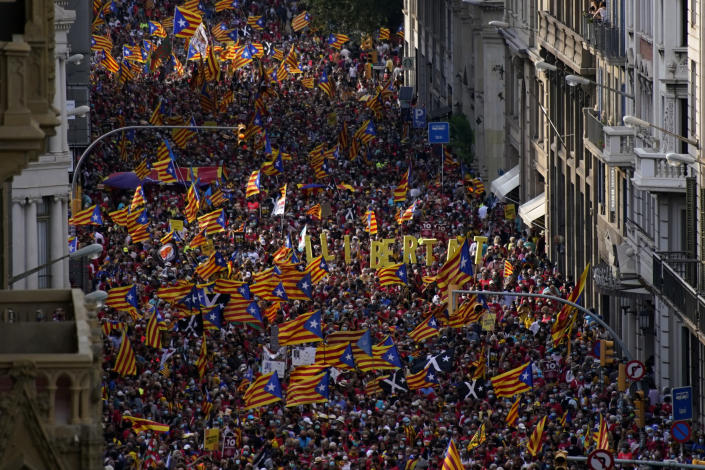 Demonstrators march during the Catalan National Day in Barcelona, Spain, Saturday, Sept. 11, 2021. Thousands of Catalans have rallied for independence from the rest of Spain in their first major mass gathering since the start of the pandemic. The march in Barcelona on Saturday comes before a meeting between regional leaders in northeast Catalonia and the Spanish government. ( AP Photo/Joan Mateu Parra)