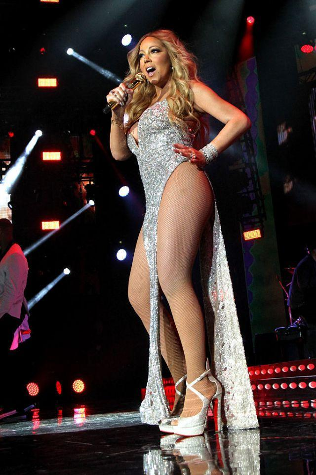 <p>Well then! The diva songstress made sure all eyes were on her when she performed at the Essence Festival in July. Her sparkly dress had just two dangling strips of fabric, in the front and back, with hip-exposing sides. (Photo: Getty Images) </p>