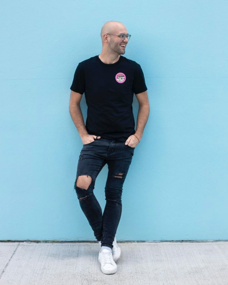 Reece Hignell in black jeans and a black T-shirt