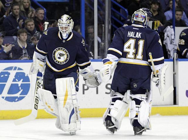 St. Louis Blues' Brian Elliott, left, replaces goalie Jaroslav Halak (41) after he surrendered three quick goals in the first period of an NHL hockey game against the Anaheim Ducks, Saturday, Dec. 7, 2013, in St. Louis. (AP Photo/Tom Gannam)