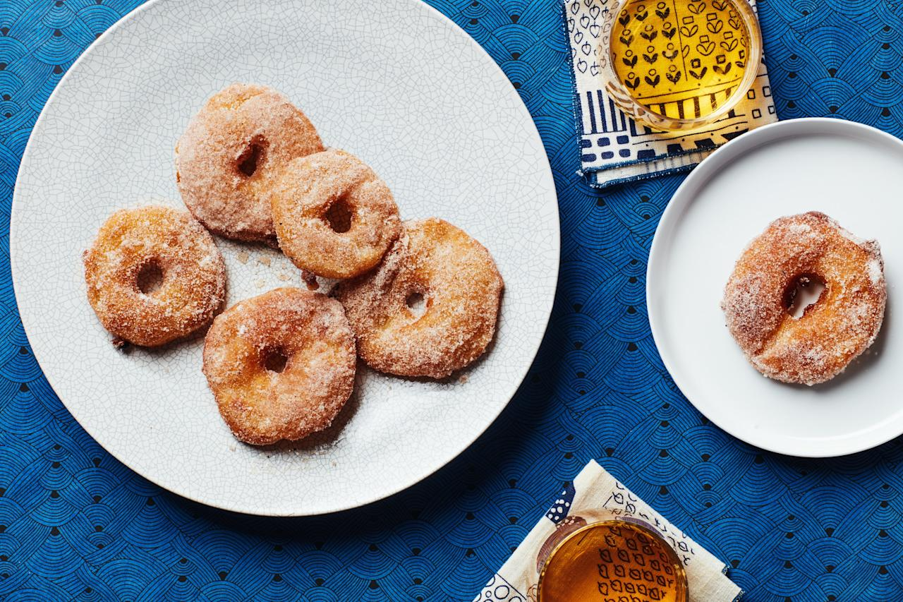"""Cinnamon, cardamom, and freshly ground black pepper lend warm spice to these sweet fritters. Any firm apple works well here. Try Honeycrisp or Pink Lady for sweet floral notes, or Granny Smith, if you prefer a little tartness. A mix of apples is also fun. <a href=""""https://www.epicurious.com/recipes/food/views/apple-fritters-with-spiced-sugar?mbid=synd_yahoo_rss"""">See recipe.</a>"""