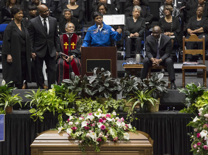 """NASA astronaut Dr. Yvonne Cagle speaks at a memorial service for Katherine Johnson on Saturday, March 7, 2020, at Hampton University Convocation Center in Hampton, Va. Johnson, a mathematician who calculated rocket trajectories and earth orbits for NASA's early space missions and was later portrayed in the 2016 hit film """"Hidden Figures,"""" about pioneering black female aerospace workers died on Monday, Feb. 24, 2020. She was 101. (Kaitlin McKeown /The Virginian-Pilot via AP)"""