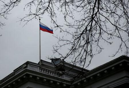 FILE PHOTO: A Russian flag flies atop the Consulate General of the Russian Federation in Seattle, Washington, U.S., March 26, 2018.  REUTERS/Lindsey Wasson/File Photo