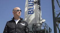 This April 24, 2015 handout photograph obtained courtesy of Blue Origin shows Jeff Bezos at New Shepard's West Texas launch facility before the rocket's maiden voyage