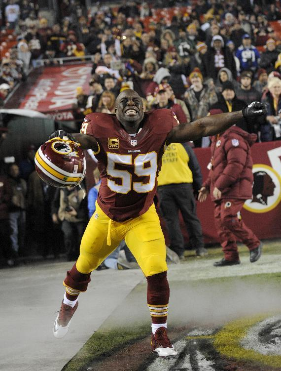 Washington Redskins inside linebacker London Fletcher (59) reacts during player introductions before an NFL football game against the New York Giants, Sunday, Dec. 1, 2013, in Landover, Md. (AP Photo/Nick Wass)