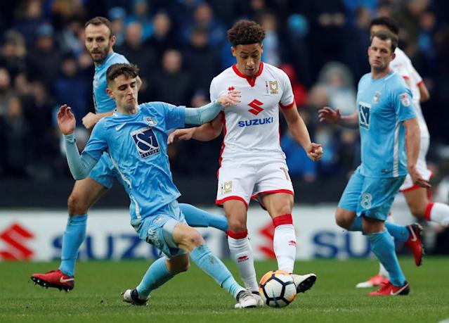 Soccer Football - FA Cup Fourth Round - Milton Keynes Dons vs Coventry City - Stadium MK, Milton Keynes, Britain - January 27, 2018 Coventry's Tom Bayliss in action with MK Dons' Marcus Tavernier Action Images/Andrew Boyers