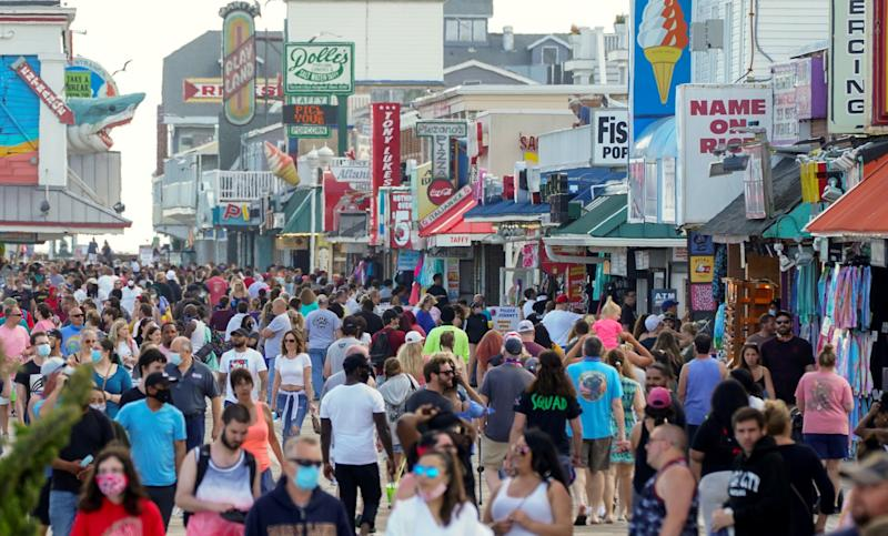 With the relaxing of the coronavirus disease (COVID-19) restrictions, visitors crowd the boardwalk on Memorial Day weekend in Ocean City, Maryland, U.S., May 23, 2020. REUTERS/Kevin Lamarque TPX IMAGES OF THE DAY