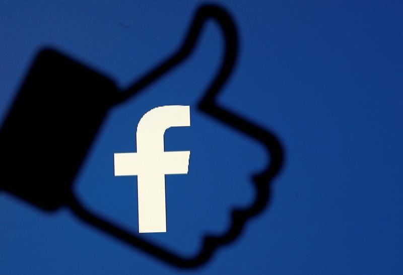 FILE PHOTO: A 3D-printed Facebook like button is seen in front of the Facebook logo, in this illustration taken October 25, 2017. REUTERS/Dado Ruvic/Illustration/File Photo