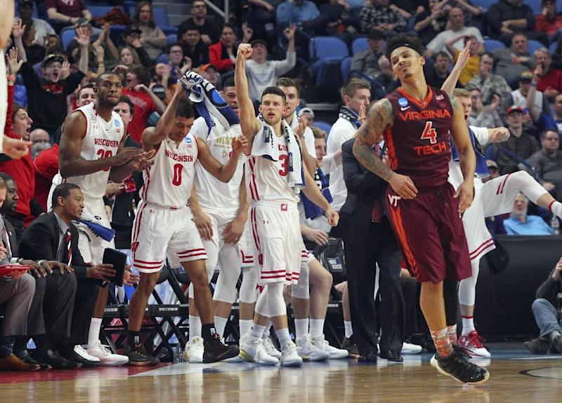 Wisconsin players celebrate a Wisconsin score as Virginia Tech guard Seth Allen (4) reacts late in the the second half of a first-round game in the NCAA men's college basketball tournament, Thursday, March 16, 2017, in Buffalo, N.Y. Wisconsin won 84-74. (AP Photo/Bill Wippert)